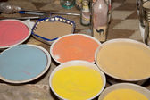 Multicolored sand for traditional souvenirs (bottles with sand and shapes of desert and camels) in Jordan — Stock Photo