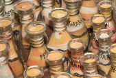 Traditional local souvenirs in Jordan- bottles with sand and shapes of desert and camels — Stock Photo