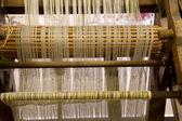 Old silk machines in Chinese factory, Beijing, China — Stock Photo