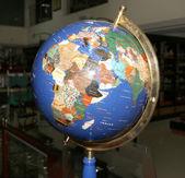 Old fashioned globe on on dark background — Stock Photo