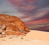 Wadi Rum Desert also known as The Valley of the Moon is a valley cut into the sandstone and granite rock in southern Jordan 60 km to the east of Aqaba — Stock Photo