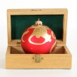 Christmas decoration in a wooden box on a white background — Stock Photo #6687194