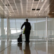 Silhouettes at airport building — Stock Photo #9899125