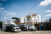 Chemical Storage Tank And Tanker Truck — Stock Photo
