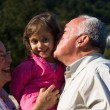 Happy Grandfather, Grandmother and grandchild — Stock Photo #19592669