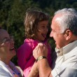 Happy Grandfather, Grandmother and grandchild — Stock Photo #19592709
