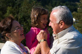 Happy Grandfather, Grandmother and grandchild — Stock Photo