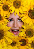 Happy young woman with sunflowers — Stock Photo
