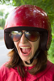 Young scared woman in motorcycle helmet — Stock Photo