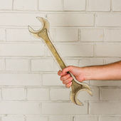Big spanner in a man hand — Stock Photo