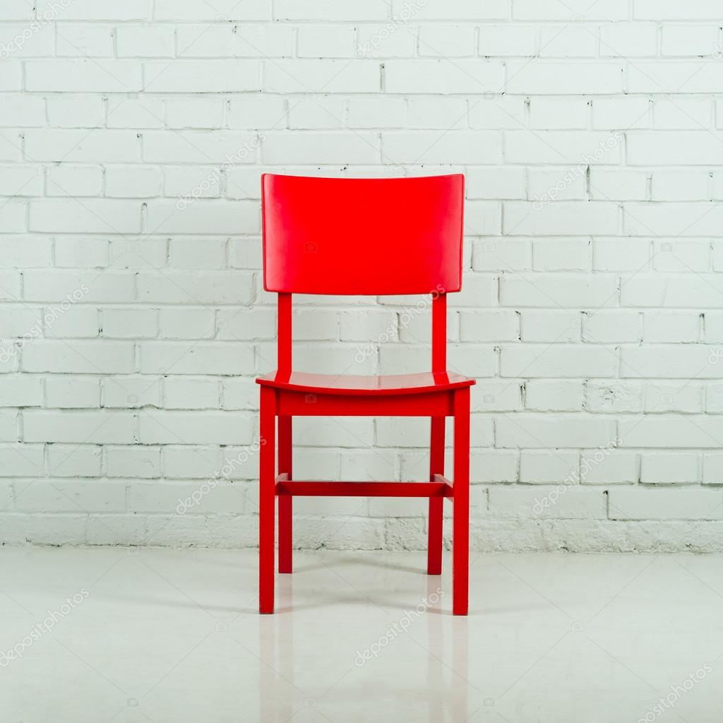 red wooden chair in empty white room against a brick wall stock photo dmitry zimin 26337223. Black Bedroom Furniture Sets. Home Design Ideas