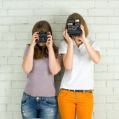 Young girls taking picture — Stock Photo