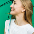 Happy smiling girl holding a green umbrella — Stock Photo
