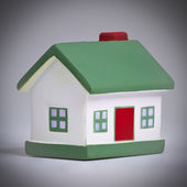 A little house with a green roof — Stock Photo