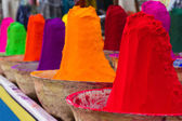 Piles of colorful powdered dyes used for holi festival — Stockfoto