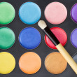 Colorful make-up palette with professional make-up brush — Stock Photo