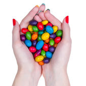 Woman hands holding candy — Stock Photo