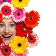 Happy smiling girl with flowers around face isolated on white — Stock Photo #31356321