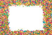 Colorful candy decoration frame — Stock Photo