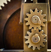 Close-up old cog wheels meshing together — Stock Photo