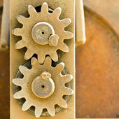 Old metal cog gears meshing together — Stockfoto