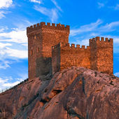 Medieval Genoese fortress against blue sky with clouds — Stock Photo