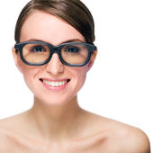 Beautiful smiling young woman wears glasses — Stock Photo
