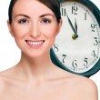 Time concept. Portrait of beautiful smiling young woman. — Stock Photo