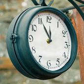 Vintage street clock. 5 minutes to twelve concept — Stock Photo