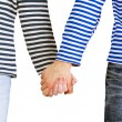 Stock Photo: Man and woman holding hands together