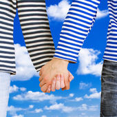 Man and woman holding hands together — Stockfoto