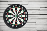 Darts board on a vintage wall — Stock Photo