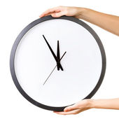 Woman holding a big clock isolated on a white background. — Stock Photo