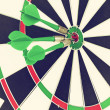 Darts arrows in target center — Stok Fotoğraf #41971161