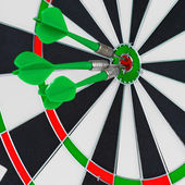 Darts arrows in the target center — Stock Photo