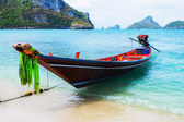 Long tail boat on beach — Stock Photo