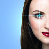 Woman with lines scanning the eye — Stock Photo