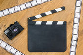 Film slate and film strips — Stock Photo