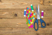 Sewing buttons, scissors and thread rolls — Стоковое фото