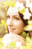 Beauty face with flowers — Stock Photo