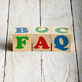Wooden blocks with FAQ sign — Stock Photo