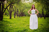 Bride against a green summer park — Stock Photo