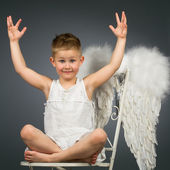 Happy kid with wings — Stock Photo