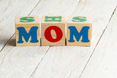 Wooden blocks with MOM word — Stock Photo