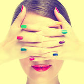 Woman with colorful manicure. — Stock Photo