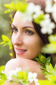 Woman with white blossom flowers — Stock Photo