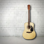 Acoustic guitar in room — Stock Photo