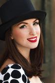 Woman wearing top hat — Stock Photo