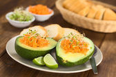 Avocado with Grated Carrot and Sprouts — Stock Photo