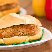 Fried Bratwurst in Bun — Stock Photo